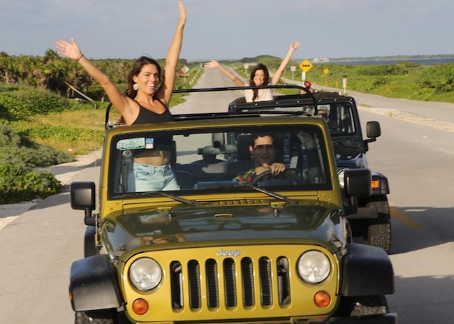 Cheryl in a jeep with her friends in Cozumel.