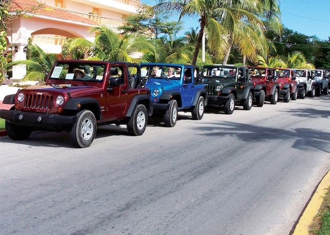The Jeeps waiting for tourists to start the tour in Cozumel.