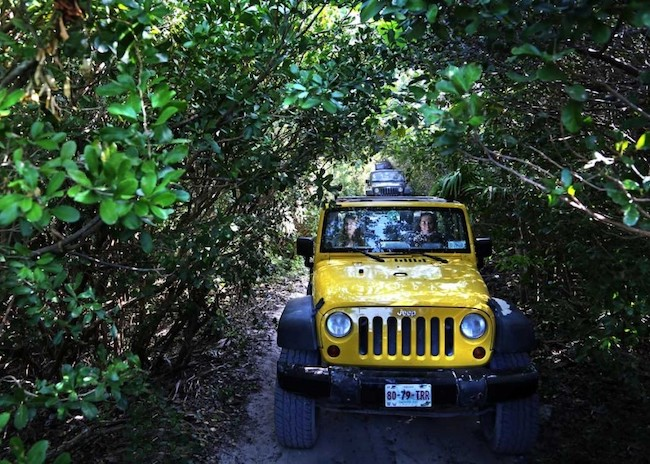 Clara and her friends exploring Cozumel in a yellow jeep.